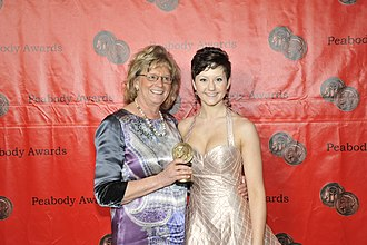 Degrassi: The Next Generation - Linda Schuyler and Jordan Todosey holding award at the 70th Annual Peabody Awards