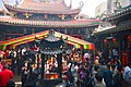Locals burn incense at temple, offering homage to their ancestors, the gods, or sending a wish to heaven. - panoramio.jpg