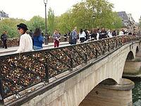 Love padlocks and tourists on the Pont de l'Archevêché in Paris
