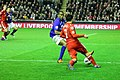 Luis Suarez runs at Distin 4.jpg