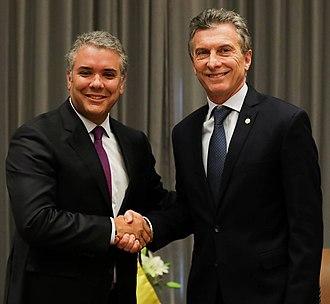 Iván Duque Márquez - Duque (left) shakes hands with Argentinian President Mauricio Macri in August 2018