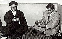 Mahmoud Taleghani gives a Quran as gift to Gholamreza Takhti in a meeting, Hedayat Mosque, Tehran - 1957.jpg