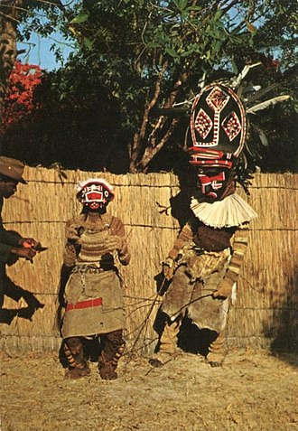 Makishi dancer, found in North-Western Zambia, represent spirits of a deceased who returns to assist the living Makishi.jpg
