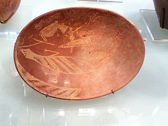 Early Dynastic Period (Egypt) - A plate created during the Early Dynastic period of Ancient Egypt.  It depicts a man on a boat alongside a Hippopotamus and a Crocodile