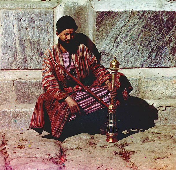 File:Man sitting and holding a hookah.jpg