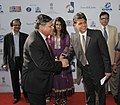 Manish Tewari being received by the Secretary, Ministry of Information & Broadcasting, Shri Uday Kumar Varma, at the inaugural ceremony of the 43rd International Film Festival of India (IFFI-2012), in Panaji, Goa.jpg