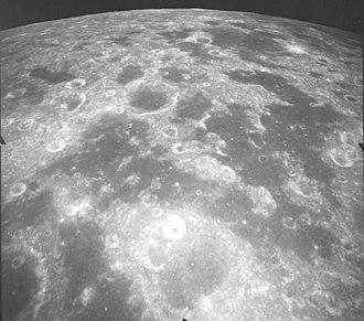 Mare Undarum - Oblique view of Mare Undarum (foreground) and Mare Spumans (upper right), facing south, from Apollo 17