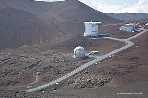 Opposition to the Mauna Kea Observatories - Three of Mauna Kea's existing telescopes: the Caltech Submillimeter Observatory (foreground), the James Clerk Maxwell Telescope (middle distance), and the Submillimeter Array (background)