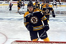 9d771ff87 Charlie McAvoy and other players warming up prior to a game in the 2017  Stanley Cup playoffs. The Bruins qualified for the Stanley Cup playoffs for  the ...