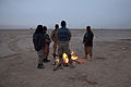 Members of the Afghan National Civil Order Police warm themselves around a fire during a break from operations in the Maiwand district, Kandahar province, Afghanistan, Feb 120226-A-QD683-004.jpg