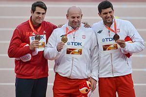2015 World Championships in Athletics – Men's discus throw - Discus medalists L-R Milanov, Małachowski, Urbanek