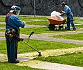 Men working on lawns at Ciudad Universitaria, Mexico City.jpg