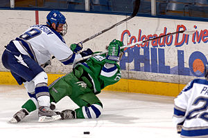 Mercyhurst University - A Mercyhurst hockey player (center) jostling for the puck with an Air Force Falcons defenceman.