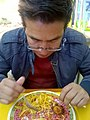 Mexican man eating chinese food in San Martín Texmelucan, Puebla.jpg