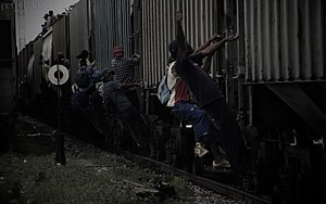"2014 American immigration crisis - Immigrants jumping on ""La Bestia"" that will take them to the Mexican-American border."