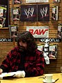Mick Foley signing autographs.jpg