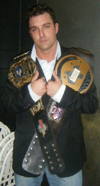 Mike DiBiase (born 1977) - DiBiase in 2008 with the NWA North American Heavyweight Championship and NWA Texas Heavyweight Championship.