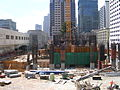 Millennium Tower (301 Mission Street) SF under construction, showing the crane footing, concrete core and construction equipment. The Transbay Terminal is visible to the left.JPG
