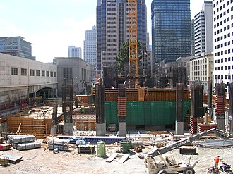 Millennium Tower (San Francisco) - Image: Millennium Tower (301 Mission Street) SF under construction, showing the crane footing, concrete core and construction equipment. The Transbay Terminal is visible to the left
