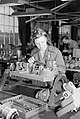 Mrs Irene Stacey at her workbench in a factory in Bristol during 1942. D10433.jpg