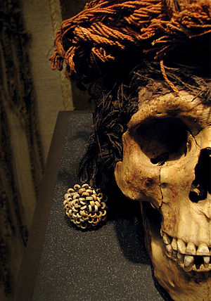 Candelaria Cave - Detail of a skull found in Cueva de la Candelaria. Wears a head ornament made from vegetal fibers and seashell beads. Currently displayed at INAH National Anthropology Museum.