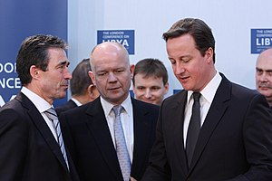 Premiership of David Cameron - Cameron and Foreign Secretary William Hague speaking to NATO Secretary General Anders Fogh Rasmussen at the London Conference on Libya, 29 March 2011.