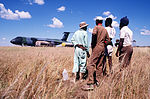 Namibian workers watch operations following the landing of a Military Airlift Command C-5B Galaxy aircraft at Grootfontein Logistics Base DF-ST-90-10120.jpg