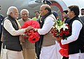 Narendra Modi being welcomed by the Union Home Minister, Shri Rajnath Singh, on his arrival, at Lucknow airport, in Uttar Pradesh. The Governor of Uttar Pradesh, Shri Ram Naik and the Chief Minister of Uttar Pradesh.jpg