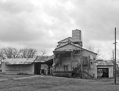 The diesel-powered gin in Burton, Texas is one of the oldest in the United States that still functions. Nation's Oldest Cotton Gin -- Burton, Texas.jpg