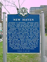 A sign on New Haven Green that details the city history.