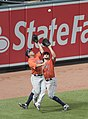 Nori Aoki and Jake Marisnick near collision in left-center field (cropped).jpg