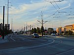 North along Constitution Blvd at the Green Line TRAX tracks, Aug 16.jpg