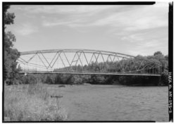 OBLIQUE ELEVATION, LOOKING NORTHEAST. - Grant Road Bridge, Spanning Raquette River at Grant Road, Raymondville, St. Lawrence County, NY HAER NY,45-RAYM,2-2.tif