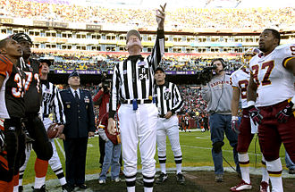 Willie Anderson (American football) - Anderson (second to left) observes a coin toss during a 2004 game against the Washington Redskins.
