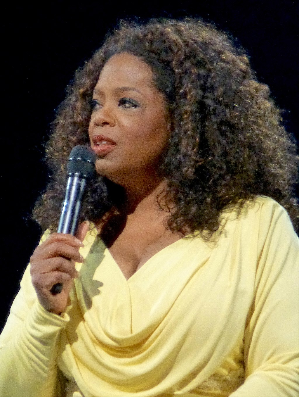 Oprah Winfrey - Charismatic leader in a yellow shirt