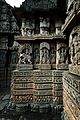 Ornate relief between eves and frieze of moldings at the base in Lakshminarayana Temple at Hosaholalu.jpg