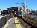 Outbound train arriving at Harvard Avenue station, December 2018.JPG
