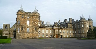 Holyrood Palace - Palace front with the abbey ruins and 16th-century north-west tower on the left. The rest dates from the 17th century. The forecourt fountain on the far right is a Victorian addition.