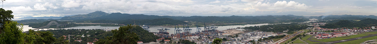 The 77 km long Panama Canal, opened in 1914, connects the Caribbean Sea to the Pacific Ocean, replacing a long and treacherous shipping route passing via the Drake Passage and Cape Horn at the tip of South America. Construction was plagued by problems, including disease (particularly malaria and yellow fever) and landslides. By the time the canal was completed, a total of 27,500 French and American workmen are estimated to have died.