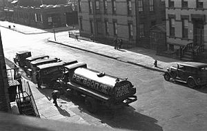 Paragon Oil - A Paragon Oil truck servicing a Brooklyn apartment building in the 1930s.