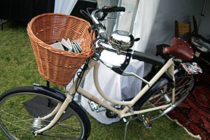 Bicycle basket - Pashley bicycle with a front wicker basket.