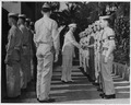 Photograph of President Truman shaking hands with members of the Marine detachment responsible for guarding the... - NARA - 200502.tif