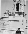 Photograph of President Truman waving from the conning tower of a submarine, the U.S.S. TUSK, during his visit to the... - NARA - 198649.tif