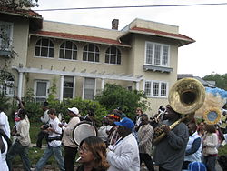 A second line parade on Fontainebleau Drive
