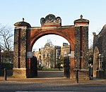 Entrance archway and gates at Pitzhanger Manor at north-east end of park