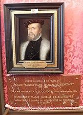 Plaque de marbre rouge surmontée d'un petit portrait peint placé sur une tenture rouge