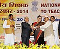 Pranab Mukherjee presenting the National Award for Teachers-2014 to Shri Angbir Rai, Sikkim, on the occasion of the 'Teachers Day', in New Delhi. The Union Minister for Human Resource Development, Smt. Smriti Irani.jpg