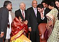 Pratibha Devisingh Patil with Beijing Olympic Gold Medalist, Shri Abhinav Bindra, at a reception hosted by the High Commissioner of India to United Kingdom, Shri Nalin Surie, in London on October 26, 2009.jpg