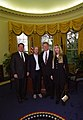 President Bill Clinton and Vice President Al Gore pose for a photo with musician Tom Petty and wife Jane Petty in the Oval Office.jpg