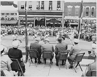 Bolivar, Missouri - Image: President Harry S. Truman and other dignitaries on the reviewing platform, watching a parade, in Bolivar, Missouri.... NARA 199906